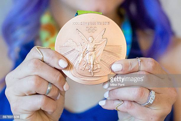 Olympic fencer Dagmara Wozniak Olympic medal detail attends the AOL Build Speaker Series to discuss 2016 Rio Olympic Fencing at AOL HQ on August 29...