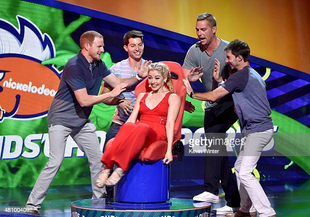 S Olympic figure skater Gracie Gold rides the Dizzy Dude with members of Dude Perfect at the Nickelodeon Kids' Choice Sports Awards 2015 at UCLA's...