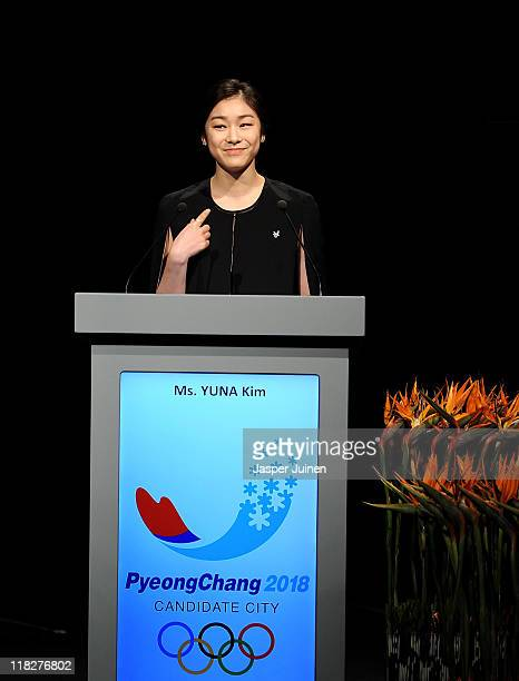 Olympic figure skating champion Yuna Kim gestures as she adresses dignitaries during the PyeongChang 2018 bid presentacion at the 123rd IOC session...