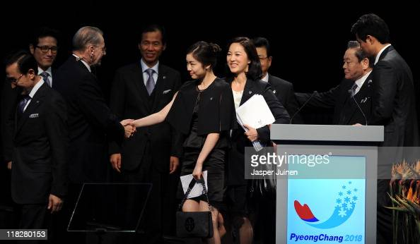 Olympic figure skating champion Yuna Kim greets IOC President Jacques Rogge at the end of the PyeongChang 2018 bid presentacion during the 123rd IOC...