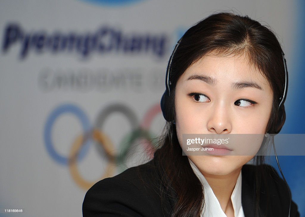 Olympic figure skating champion Yuna Kim listens to questions from the media during the PyeongChang 2018 Bid Committee press conference on July 4...