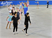 Olympic figure skating champion Yuna Kim of South Korea rides with kids at an ice rink on July 5 2011 in Durban South Africa The annual general...
