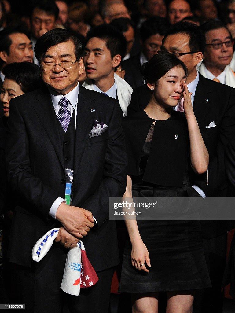 Olympic figure skating champion Yuna Kim reacts besides bid chairman Yang Ho Cho as PyeongChang is choosen as the host city for the 2018 Olympic...
