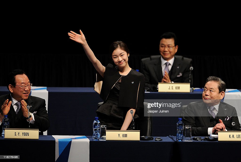 Olympic figure skating champion Yuna Kim waves to delegates at the start of the PyeongChang 2018 bid presentacion during the 123rd IOC session on...