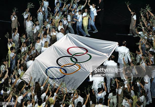 Olympic flag is carried in during the opening ceremony of the Athens 2004 Summer Olympic Games on August 13 2004 at the Sports Complex Olympic...
