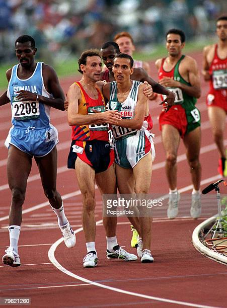 1996 Olympic Games Atlanta USA Athletics Men's 1500 Metres Final Gold medal winner Noureddine Morceli of Algeria embraces silver medal winner Fermin...