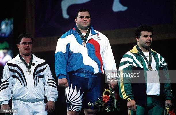 Olympic Games Atlanta USA Weightlifting 108 Kg Russian gold medal winner Andrey Chemerkin stands on the podium with German silver medallist Ronny...