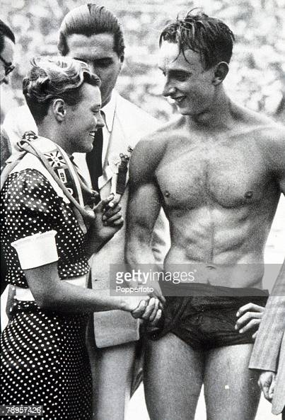 Olympic Games Berlin Germany Swimming Men's 100 Metres Freestyle Hungary's gold medal winner Ferenc Csik with Dutch swimmer Den Ouden after the race