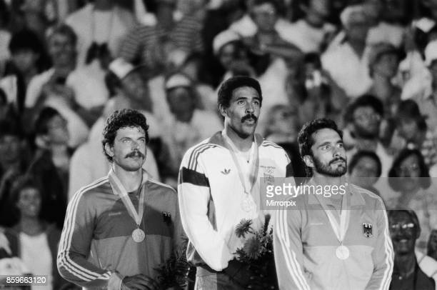 Olympic Games in Los Angeles USA Great Britain's Daley Thompson celebrates on the podium after his gold medal success in the Decathlon event He is...