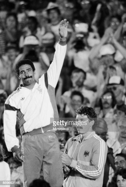 Olympic Games in Los Angeles USA Great Britain's Daley Thompson celebrates on the podium after his gold medal success in the Decathlon event Right is...