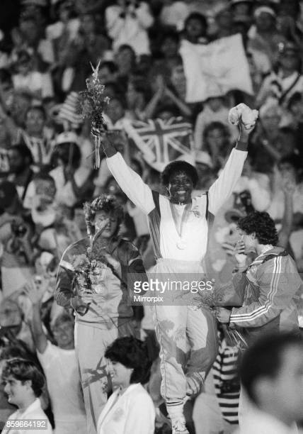 Olympic Games in Los Angeles USA Great Britain's Tessa Sanderson celebrates on the podium after winning the gold medal in the Women's Javelin event...