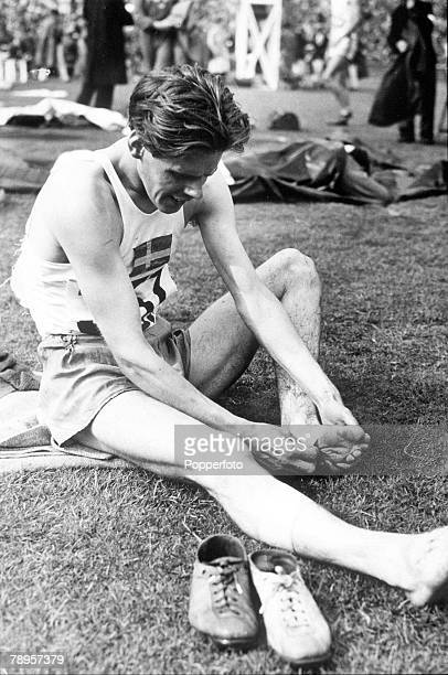 Olympic Games London England000 metres Steeplechase Swedish Gold Medal winner Thore Sjostrand examines his foot after the race