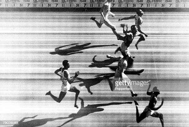 Olympic Games London England Men's 100 Metres Final Photofinish USA's Harrison Dillard about to cross the line to win the gold medal followed by...