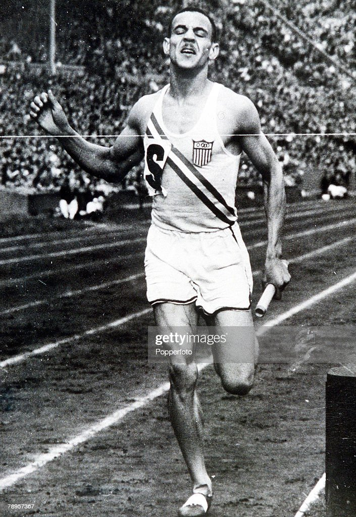 Olympic Games, London, England, Men's 4 x 400 Metres Relay, USA's Mal Whitfield crosses the line to give his team the gold medal
