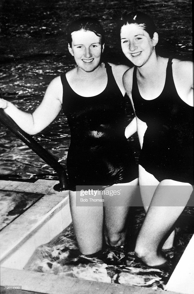 Olympic Games, Melbourne, Australia, Womens Swimming, 100 metres Freestyle, Gold Medal winner Dawn Fraser (right) is pictured with her Australian team-mate Lorraine Crapp who won Silver