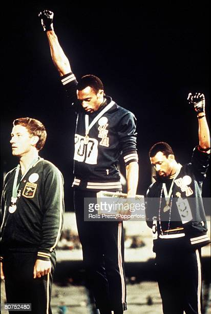 Olympic Games Mexico City Mexico Men's 200 Metres Final USA gold medallist Tommie Smith and bronze medallist John Carlos give the black power salutes...