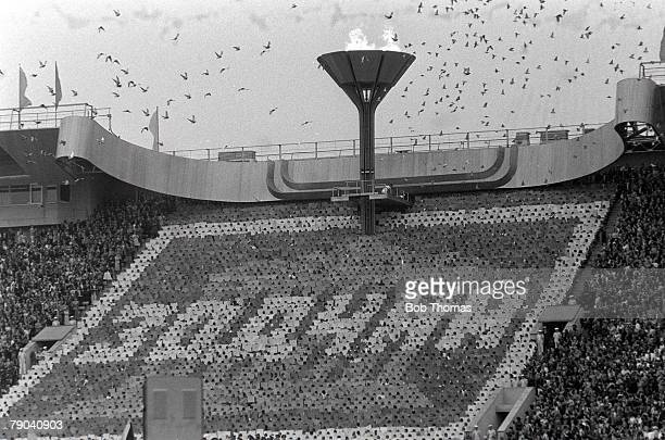 Olympic Games Moscow Russia 19th July 1980 Opening Ceremony Doves of peace are released into the air as the Olympic torch is lit during the opening...