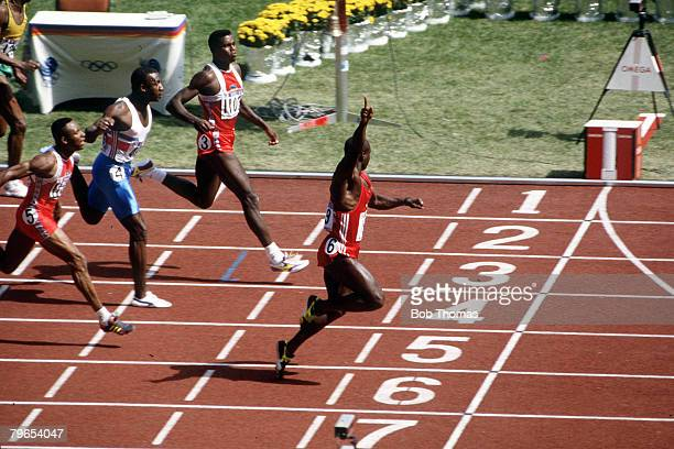 Olympic Games Seoul South Korea Men's 100 Metre Final Canada's Ben Johnson crosses the line to win the gold medal followed by USA's Carl Lewis for...