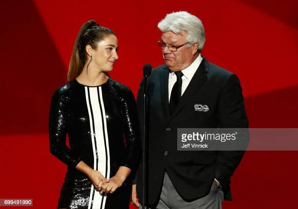 Olympic gold medal gymnast Aly Raisman and former NHL player Marcel Dionne speak onstage during the 2017 NHL Awards Expansion Draft at TMobile Arena...