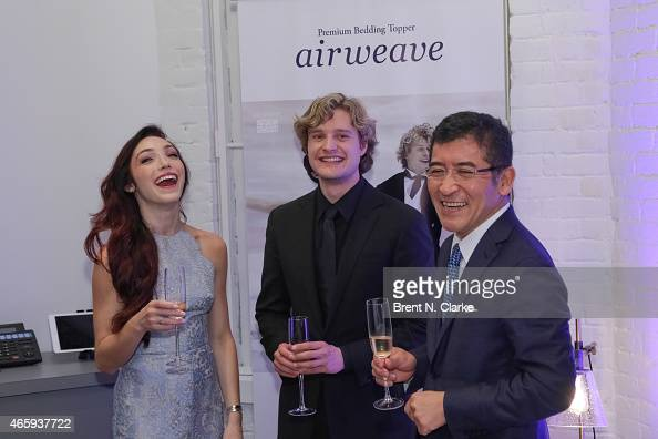 2014 Olympic Gold Medal Ice Dancing champions Meryl Davis and Charlie White appear with Airweave President and CEO Motokuni Takaoka during the...