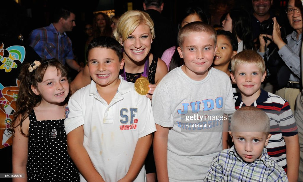 Olympic Gold Medal Winner <a gi-track='captionPersonalityLinkClicked' href=/galleries/search?phrase=Kayla+Harrison&family=editorial&specificpeople=7179048 ng-click='$event.stopPropagation()'>Kayla Harrison</a> attends her homecoming party at Empire Restaurant and Lounge on August 19, 2012 in Boston, Massachusetts. Harrison won the first U.S. Olympic gold medal in Judo at the London 2012 Olympic games.