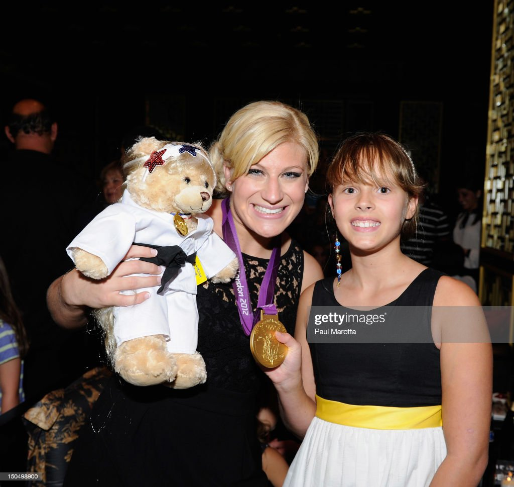 Olympic Gold Medal Winner <a gi-track='captionPersonalityLinkClicked' href=/galleries/search?phrase=Kayla+Harrison&family=editorial&specificpeople=7179048 ng-click='$event.stopPropagation()'>Kayla Harrison</a> holds her <a gi-track='captionPersonalityLinkClicked' href=/galleries/search?phrase=Kayla+Harrison&family=editorial&specificpeople=7179048 ng-click='$event.stopPropagation()'>Kayla Harrison</a> teddy bear gift from Keddy at her homecoming party at Empire Restaurant and Lounge on August 19, 2012 in Boston, Massachusetts. Harrison won the first U.S. Olympic gold medal in Judo at the London 2012 Olympic games.