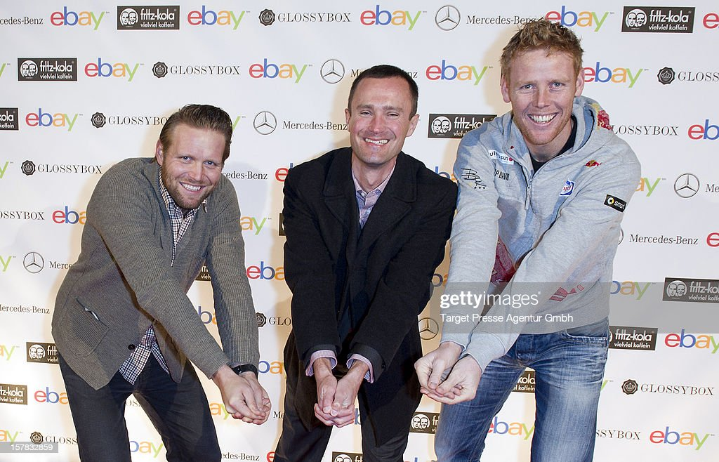 Olympic gold medal winners Jonas Reckermann (R), Ebay general manager of Germany Martin Tschopp and Julius Brink (L) attend the Ebay Pop-Up Store opening at Oranienburger Strasse on December 6, 2012 in Berlin, Germany.