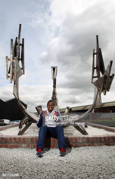 Olympic gold medal winning boxer Nicola Adams unveils a Forgemasters statue of a scorpion in Sheffield