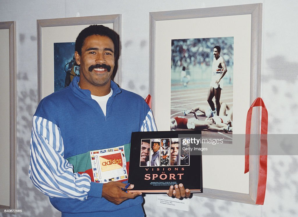 Olympic Gold medal winning decathlete Daley Thompson poses for a portrait with the first Allsport Visions of Sport book at the book launch exhibition on 14 June 1988 at the National Theatre, London, United Kingdom.