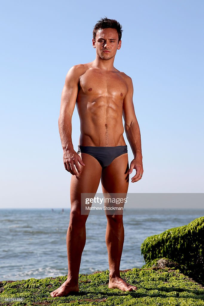 Olympic Gold Medal winning diver Tom Daley of Great Britain poses for a portrait during a break from training for the 2016 Rio Olympic Games at Quebra-Mar at Barra da Tijuca beach on January 18, 2015 in Rio de Janeiro, Brazil.