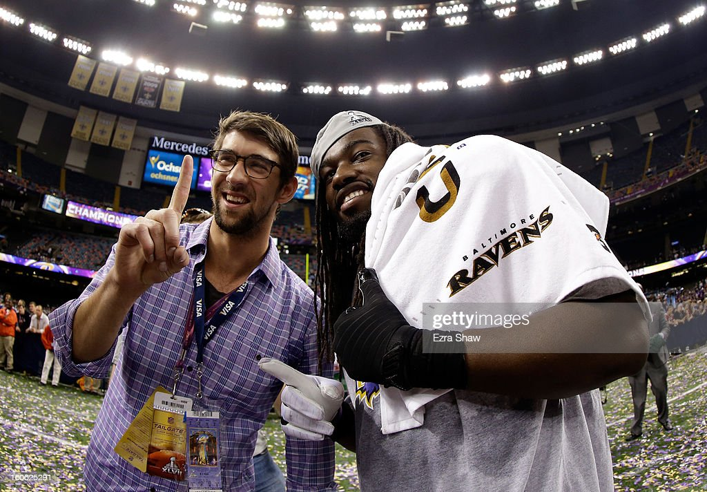Olympic gold medalist and fan of the Baltimore Ravens, Michael Phelps, celebrates with Dannell Ellerbe #59 of the Baltimore Ravens during Super Bowl XLVII at the Mercedes-Benz Superdome on February 3, 2013 in New Orleans, Louisiana.