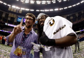Olympic gold medalist and fan of the Baltimore Ravens Michael Phelps celebrates with Dannell Ellerbe of the Baltimore Ravens during Super Bowl XLVII...