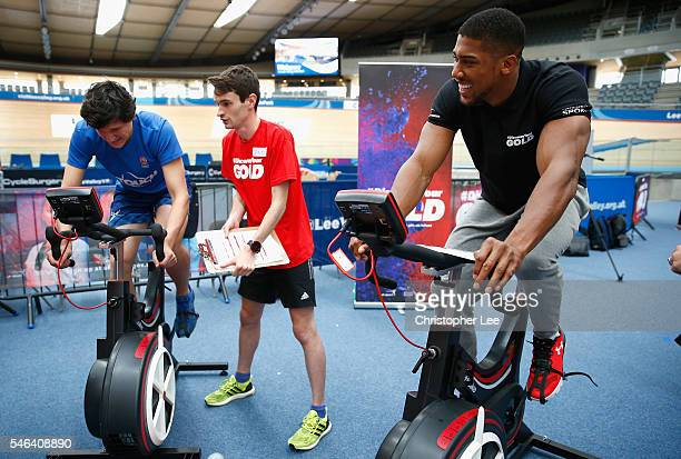 Olympic Gold Medalist Anthony Joshua of Great Britain watches over and gives encouragement as a trialist takes part during the launch of the Discover...
