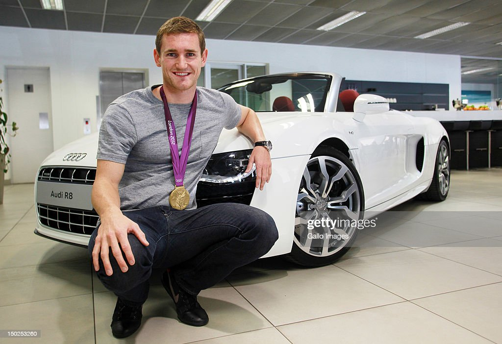Olympic gold medalist Cameron van der Burgh receives a new Audi R8 from Audi SA on August 11, 2012 in Johannesburg, South Africa.