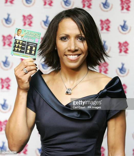 Olympic Gold Medalist Dame Kelly Holmes holds an Olympic Champions scratchcard at the launch in Piccadilly London