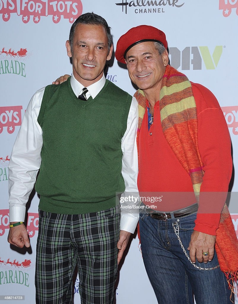 Olympic gold medalist <a gi-track='captionPersonalityLinkClicked' href=/galleries/search?phrase=Greg+Louganis&family=editorial&specificpeople=217786 ng-click='$event.stopPropagation()'>Greg Louganis</a> (R) and husband Johnny Chaillot attend The Hollywood Christmas Parade Benefiting Toys For Tots Foundation on December 1, 2013 in Hollywood, California.