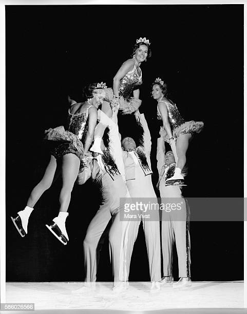 Olympic gold medalist ice skaters Barbara Wagner and Bob Paul perform their pairs lift at the Ice Capades