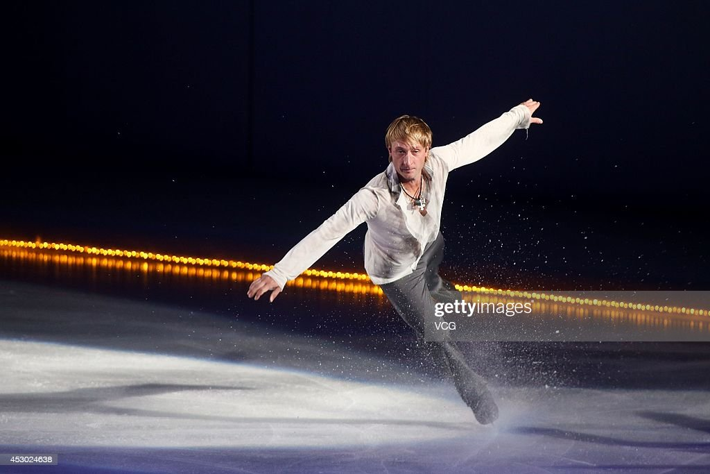 Olympic Gold medalist in figure skating <a gi-track='captionPersonalityLinkClicked' href=/galleries/search?phrase=Evgeni+Plushenko&family=editorial&specificpeople=211142 ng-click='$event.stopPropagation()'>Evgeni Plushenko</a> performs during Artistry On Ice 2014 at Guangzhou international sports and entertainment center on August 1, 2014 in Guangzhou, China.
