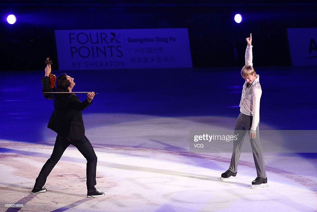 Olympic Gold medalist in figure skating Evgeni Plushenko (R) performs during Artistry On Ice 2014 at Guangzhou international sports and entertainment center on August 1, 2014 in Guangzhou, China.