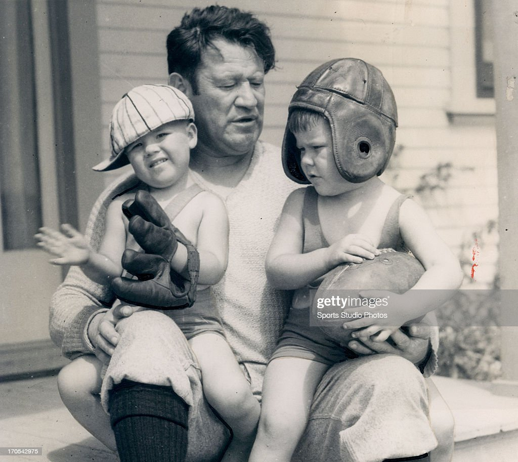 Olympic gold medalist Jim Thorpe poses with his sons Phil and Billy on September 3, 1931 in front of their home.