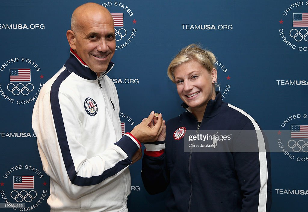 Olympic gold medalist <a gi-track='captionPersonalityLinkClicked' href=/galleries/search?phrase=Kayla+Harrison&family=editorial&specificpeople=7179048 ng-click='$event.stopPropagation()'>Kayla Harrison</a> receives the O.C. Tanner Inspiration Award, a 14K gold commemorative ring, from Peter Zeytoonjian, USOC Managing Director of Products and Licensing, at USA House on August 10, 2012 in London, England. Harrison, the first-ever U.S. athlete to win gold in judo, will later present the ring to her mentor and coach, Jimmy Pedro Sr., for inspiring her Olympic journey