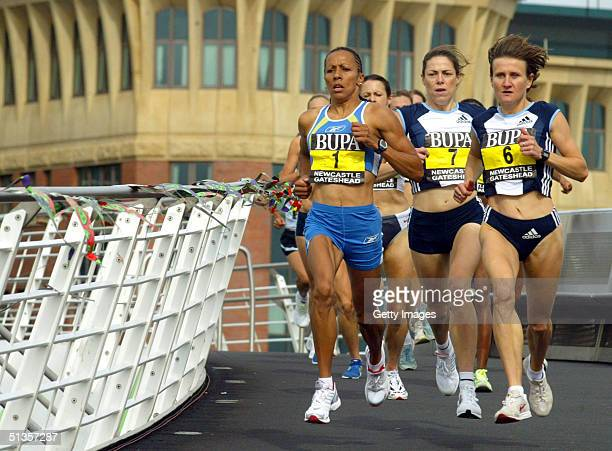 Olympic Gold medalist Kelly Holmes of the United Kingdom runs over the Millenium Bridge on her way to winning The Great North Run September 25 2004...