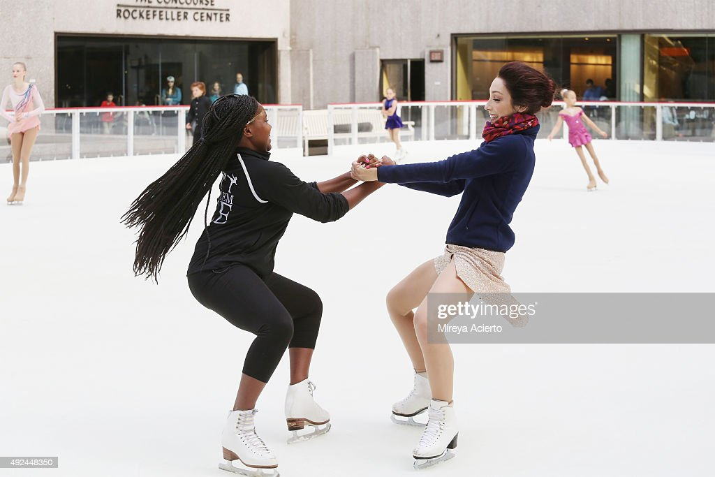 Olympic Gold Medalist Meryl Davis (R) and a child figure skater from ...