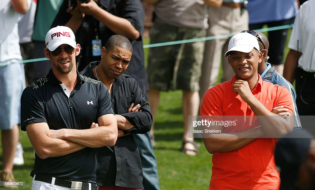 Olympic gold medalist Michael Phelps (L) and actor Will Smith (R) watch as Michael Jordan putts during ARIA Resort & Casino's Michael Jordan Celebrity Invitational golf tournament at Shadow Creek on April 6, 2013 in North Las Vegas, Nevada.