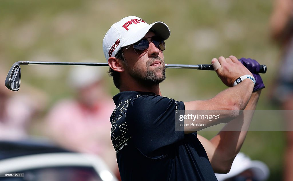 Olympic Gold Medalist <a gi-track='captionPersonalityLinkClicked' href=/galleries/search?phrase=Michael+Phelps&family=editorial&specificpeople=162698 ng-click='$event.stopPropagation()'>Michael Phelps</a> hits a tee shot during ARIA Resort & Casino's Michael Jordan Celebrity Invitational golf tournament at Shadow Creek on April 6, 2013 in North Las Vegas, Nevada.