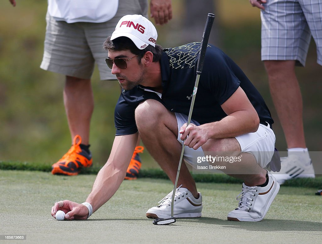 Olympic Gold Medalist <a gi-track='captionPersonalityLinkClicked' href=/galleries/search?phrase=Michael+Phelps&family=editorial&specificpeople=162698 ng-click='$event.stopPropagation()'>Michael Phelps</a> lines up a putt during ARIA Resort & Casino's Michael Jordan Celebrity Invitational golf tournament at Shadow Creek on April 6, 2013 in North Las Vegas, Nevada.