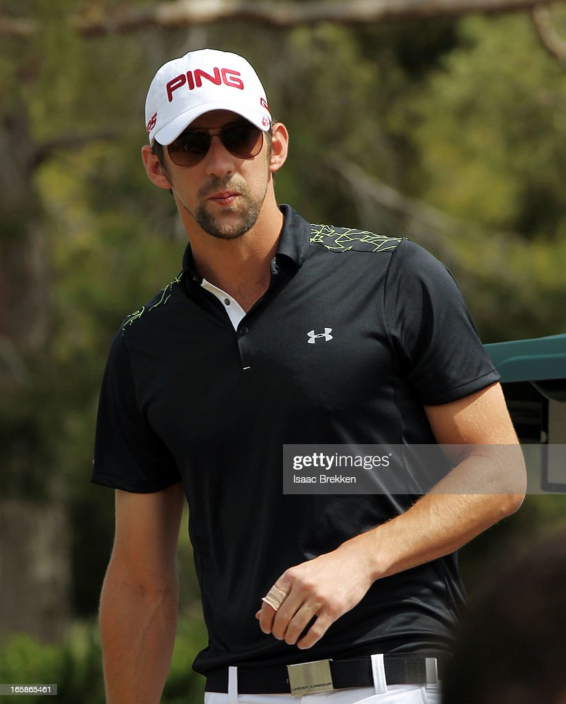 Olympic gold medalist Michael Phelps prepares to tee off during ARIA Resort & Casino's Michael Jordan Celebrity Invitational golf tournament at Shadow Creek on April 6, 2013 in North Las Vegas, Nevada.