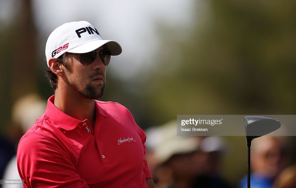 Olympic gold medalist Michael Phelps watches his tee shot during the final round of ARIA Resort & Casino's Michael Jordan Celebrtiy Invitational golf tournament at Shadow Creek on April 7, 2013 in North Las Vegas, Nevada.