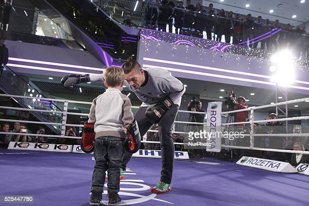 Olympic Gold Medalist Oleksandr Usyk play with kid while he performs open training before his fight against Danie Venter Oleksandr Usyk makes his...