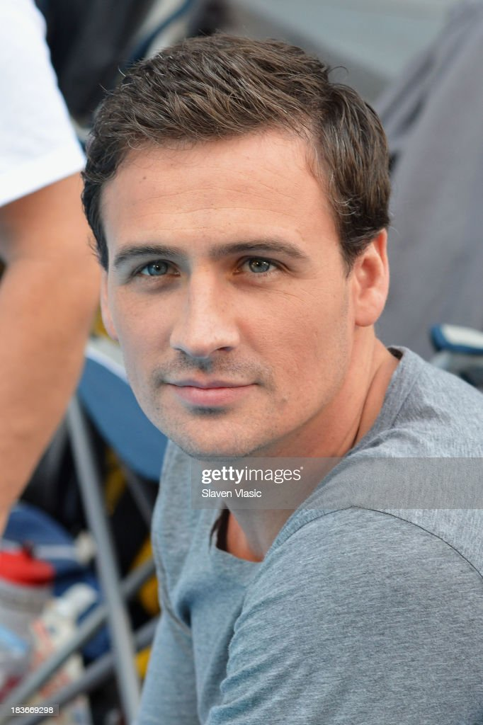 Olympic Gold Medalist <a gi-track='captionPersonalityLinkClicked' href=/galleries/search?phrase=Ryan+Lochte&family=editorial&specificpeople=182557 ng-click='$event.stopPropagation()'>Ryan Lochte</a> attends day 1 of 'Swim For Relief' Benefiting Hurricane Sandy Recovery at Herald Square on October 8, 2013 in New York City.